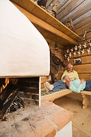 Senior couple relaxing in hunting lodge (thumbnail)