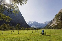 Austria, Karwendel, Senior woman biking