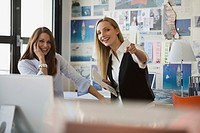 Two women in office, smiling (thumbnail)