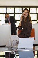 Business people in office using mobile phones