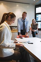 Business people in office, woman looking at documents