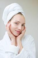 Young woman wearing towel on head, portrait