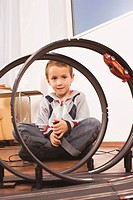Boy 4_5 playing with toy racetrack