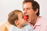 Father and son 4_5, fooling about, boy with clown nose