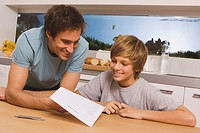 Father and son 13_14 looking at report card