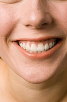 Young woman smiling, close up
