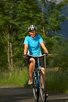 Germany, Bavaria, Walchensee, Woman mountain biking