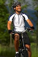 Germany, Bavaria, Walchensee, Man mountain biking