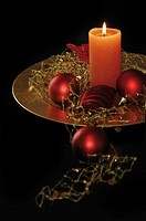 Christmas decoration, baubles and candle light