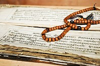 Tibetan prayer beads and ancient holy text Chemre, Ladakh, India