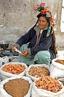 Ladakhi woman selling apricots in the market Leh, Ladakh, India