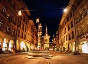 Clock tower, fountain, night view, Berne, Switzerland, Europe