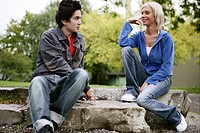 teenage couple, flirting, park, jeans, young adult