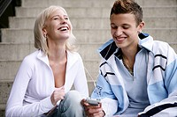 teenage couple, happy, mp3 player, listening, youn