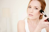 Young, woman, applying, powder, brush, cheek, beau (thumbnail)