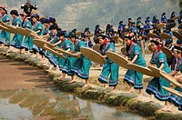 Hani Akha women sifting rice at a festival in Yuanyang China
