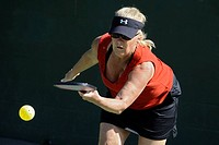 Senior citizens compete in game of Pickleball in the Senior state Olympics near Naples Florida