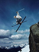Skier jumping of rock