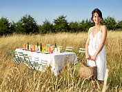 Woman standing next to a table, outdoors
