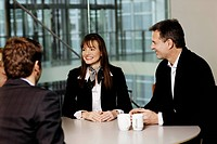 People smiling in a business meeting