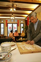 Chinese mature man make Chinese dumpling on New Year´s Eve