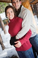 Couple in winter clothes hugging