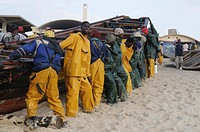Fishermen pushing their boats back on the beach Nouakchott Western Africa Mauretania Africa