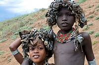 Young Dasenech kids with caps on their hats Omovalley Ethiopia Africa