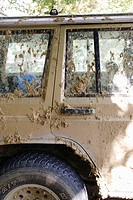side of mud-encrusted Jeep