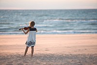 Girl playing the violin on a beach, Warrens Dunes State Park, Michigan
