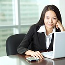 Businesswoman in office working at desk
