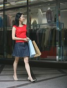 Woman window shopping with Shopping Bag