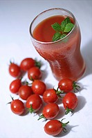 Glass of tomato juice and tomatoes, elevated view