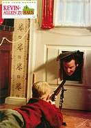 movie, Home Alone, USA, 1990, director: Chris Columbus, scene with: Macaulay Culkin, cat flap, front door, weapon, fire arm, gun, rifle, boy, child,