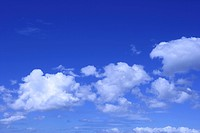 Cumulus clouds against blue sky