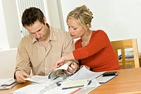 Young couple with documents and files