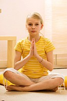 girl making yoga