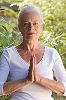 Elderly lady practicing yoga