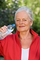 Elderly lady drinking water