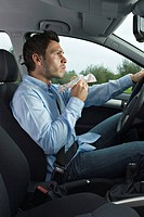 Driver eating a sandwich