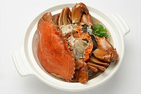 Crab with caraway in white clay pot