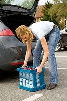 Woman lifting a beverage crate