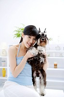 Young woman embracing Wire Fox Terrier, sitting, close_up
