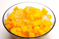 Sliced mango in dessert bowl
