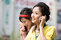 Three young women on the phone