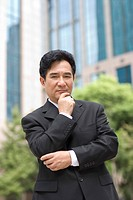 Businessman posing looking at camera outdoors