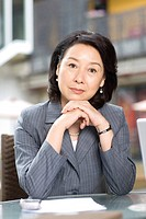 Businesswoman leaning on coffee table