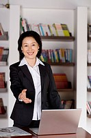 Businesswoman extending hand to shake