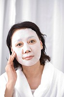 Senior woman with facial mask