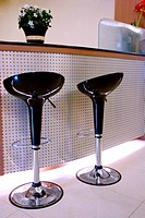 Two stools by counter